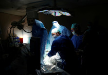 Doctors treat a patient during a pilot of an Israeli-developed photodynamic therapy to kill prostate