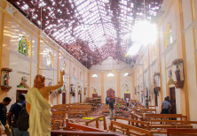 A blood-spattered statue of Jesus Christ inside St Sebastian's Church in Negombo, Sri Lanka April