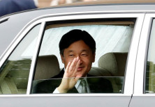 Japan's new Emperor Naruhito waves as he arrives at the Imperial Palace in Tokyo, Japan May 1, 2019