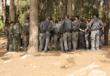 Israel Police convene near Moshav Modi'in to handle the fires that have engulfed the area