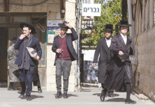 HAREDIM WALK in Jerusalem in front of a 'Men Only' sign – the role of religion in public life will l
