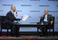 Former Israeli Prime Minister Ehud Olmert (R) speaks to Yaakov Katz at the 8th annual Jerusalem Post