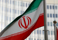 The Iranian flag flutters in front the International Atomic Energy Agency (IAEA) headquarters in Vie
