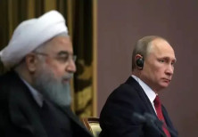 Iran's President Hassan Rouhani together with Russia's Vladimir Putin attend a joint conference