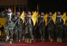 Members of Hezbollah march with party's flags during a rally marking al-Quds Day, (Jerusalem Day) in