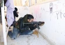 YPG FIGHTERS on a rooftop in Sere Kaniye/Ras al Ain in 2013