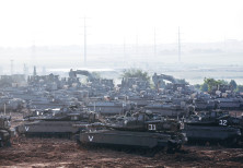 IDF tanks, armored personnel carriers (APC) and other armored vehicles gather near the border with G