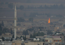 A fire is seen in the Syrian town of Ras al-Ain as seen from the Turkish border town of Ceylanpinar,