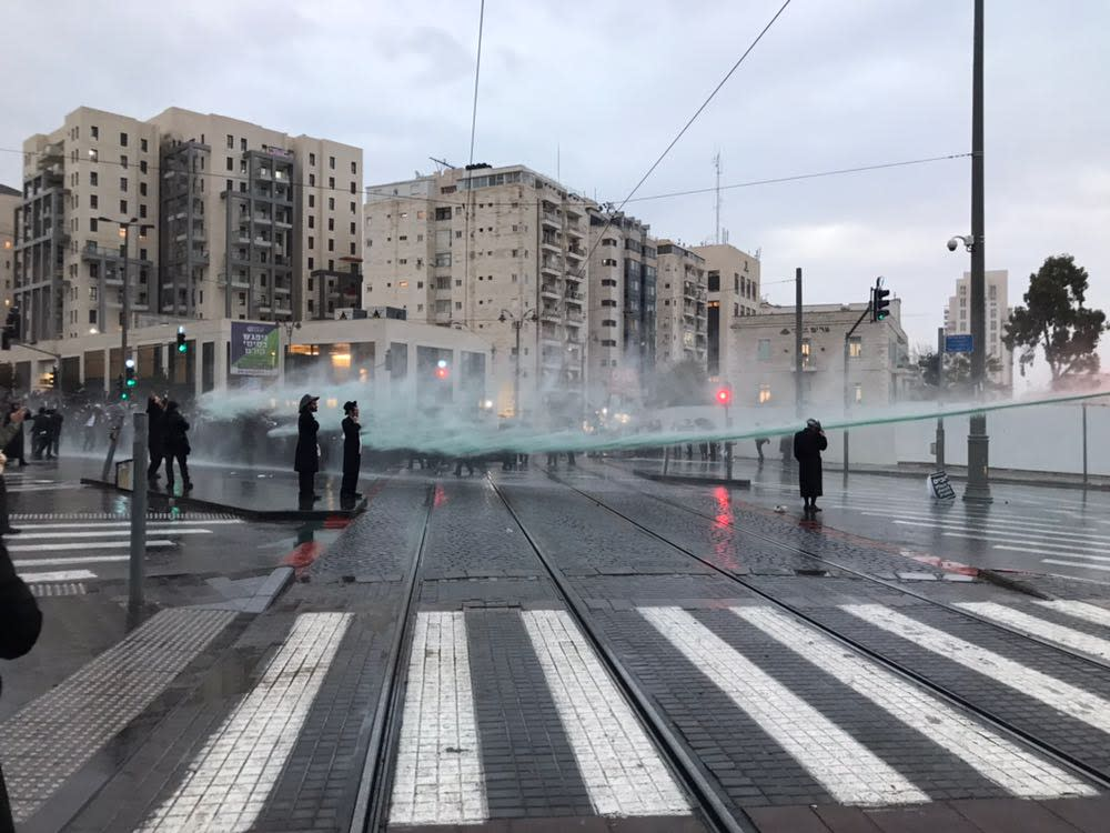 Skunk water used to disperse Haredi protests in Jerusalem.