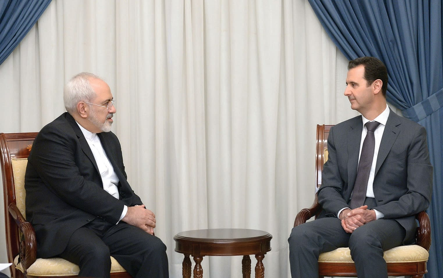 SYRIAN PRESIDENT Bashar Assad meeting with Iranian foreign minister Javad Zarif in 2015 (Reuters)