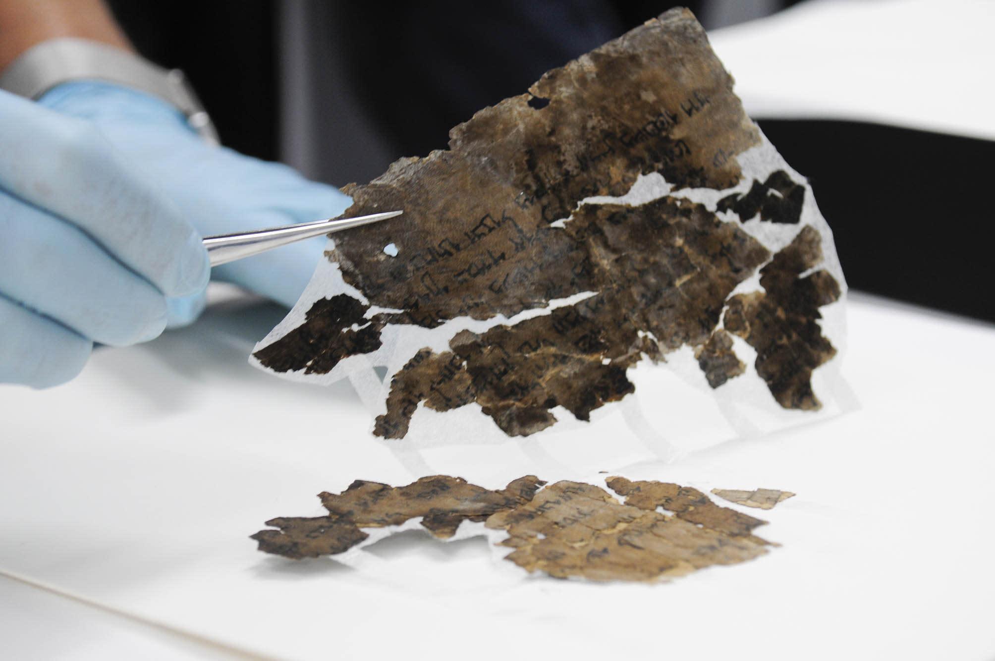 Conserving the Dead Sea Scrolls at the Israel Antiquities Authority laboratories in Jerusalem. (photo credit: SHAI HALEVI / ISRAEL ANTIQUITIES AUTHORITY)