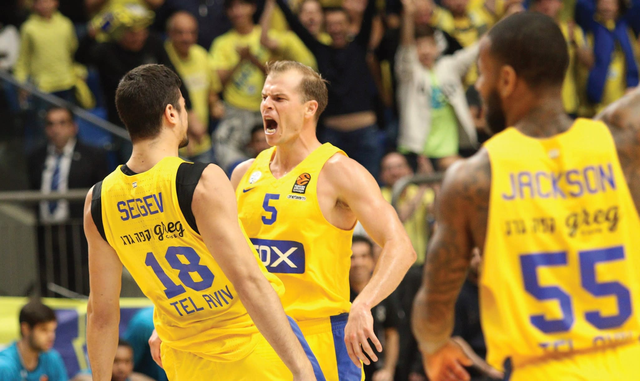 Maccabi Tel Aviv forward Michael Roll celebrates with teammate Itay Segev during a win over Real Madrid at Yad Eliyahu Arena in Tel Aviv (Adi Avishai)