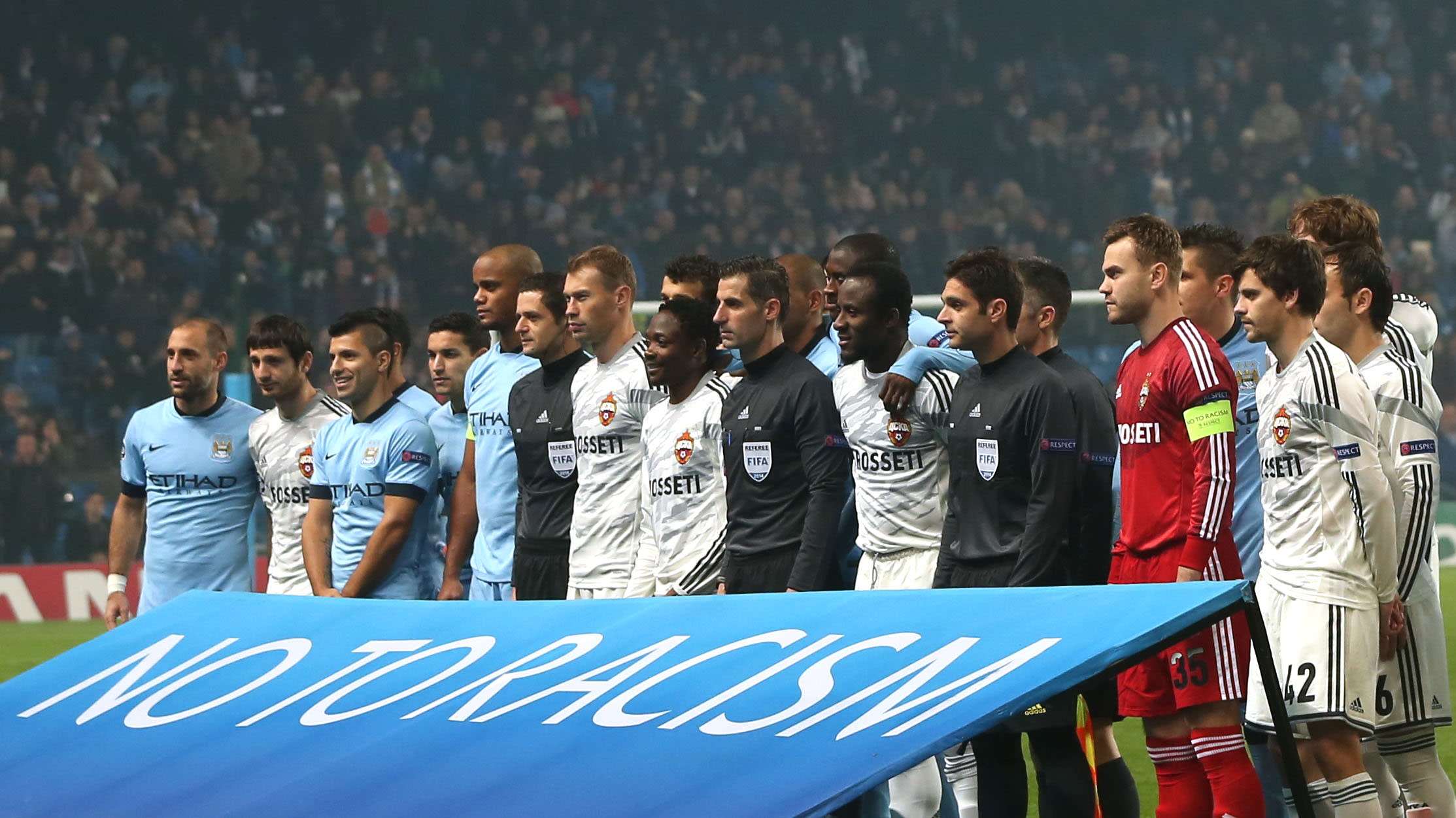 Manchester City and CSKA Moscow players with a No To Racism banner before a UEFA Champions League match (Action Images / Lee Smith via Reuters)