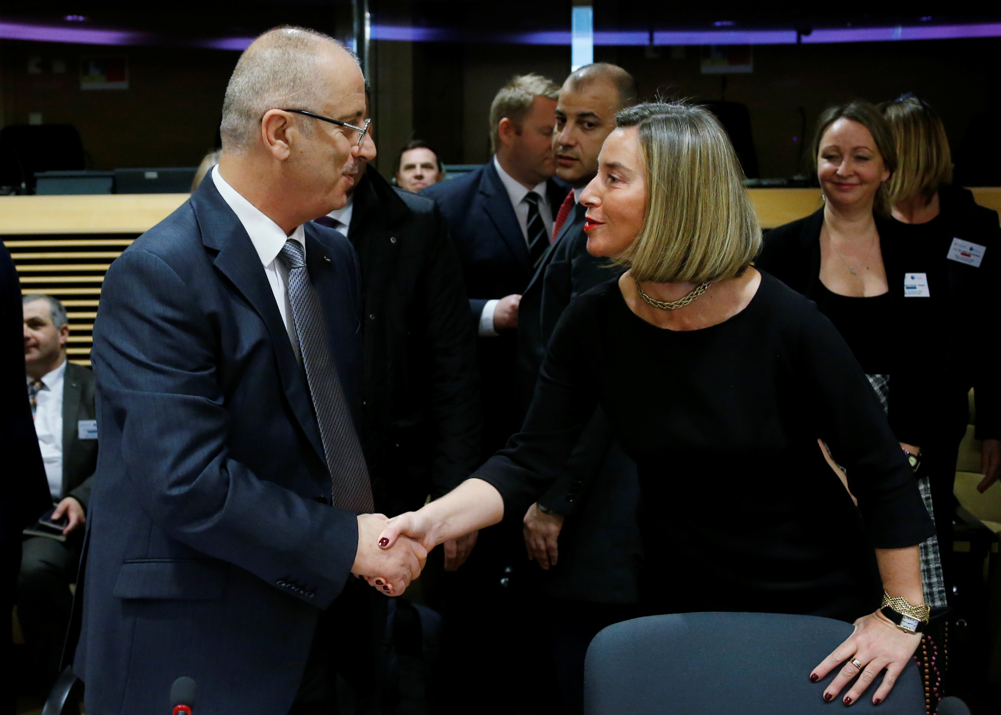 Palestinian Prime Minister Rami Hamdallah shakes hands with European Union's foreign policy chief Federica Mogherini at the EU Commission headquarters in Brussels, Belgium, January 31, 2018. (Reuters)