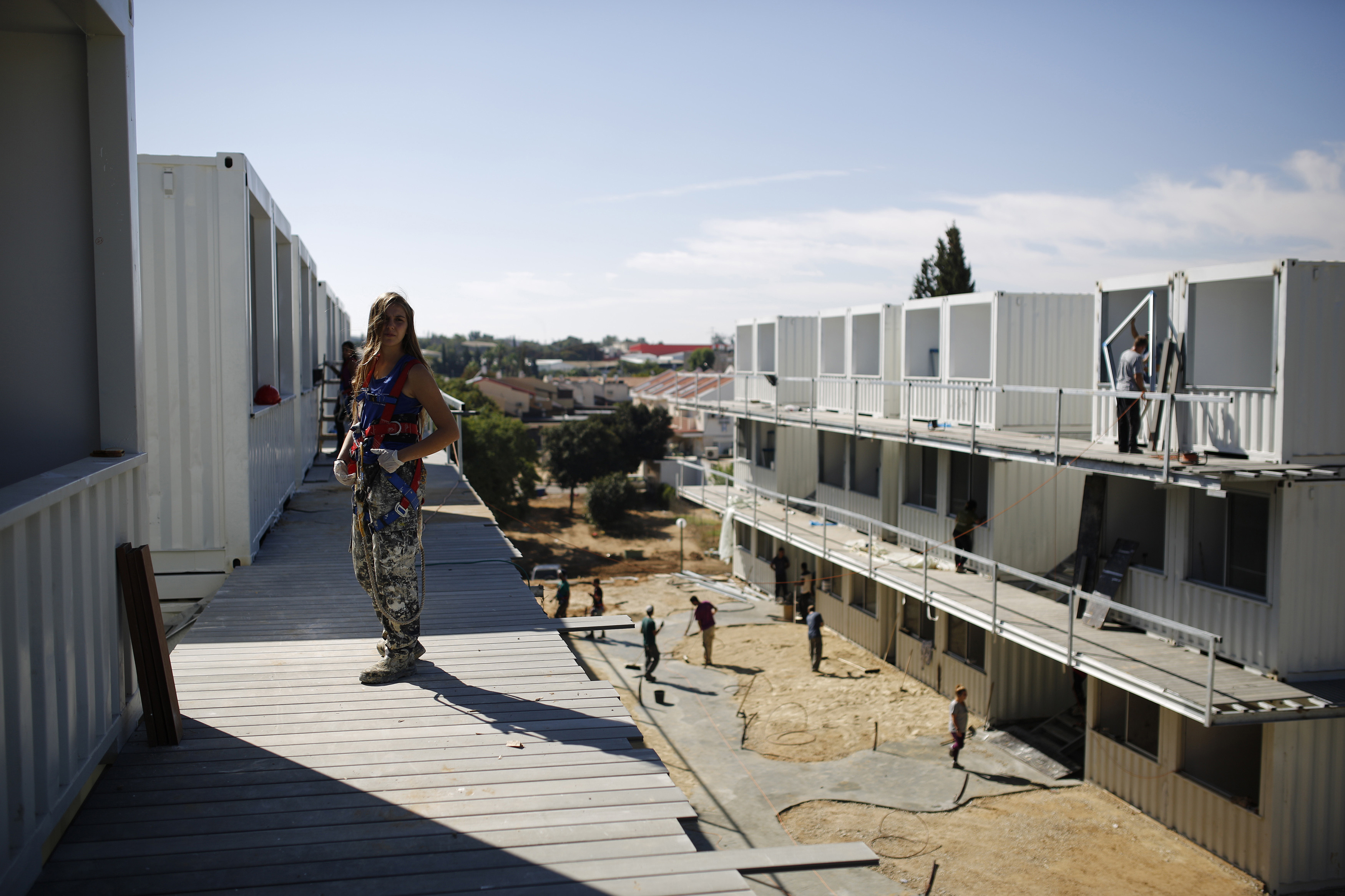 An Israeli student, who is a member of the Ayalim NGO, works at a construction site where recycled shipping containers are used to build accommodation for students in the southern Israeli town of Sderot (Reuters/Amir Cohen)