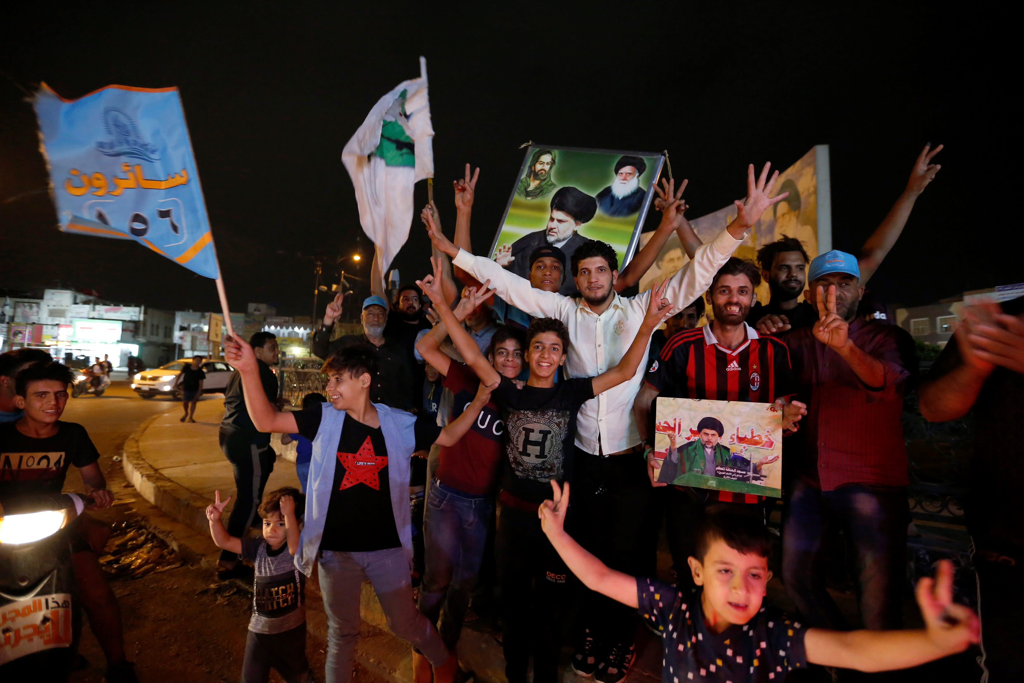 Iraqi supporters of Sairun list celebrate after the closing of ballot boxes during the parliamentary election in Sadr city district of Baghdad, Iraq May 12, 2018 (Reuters)
