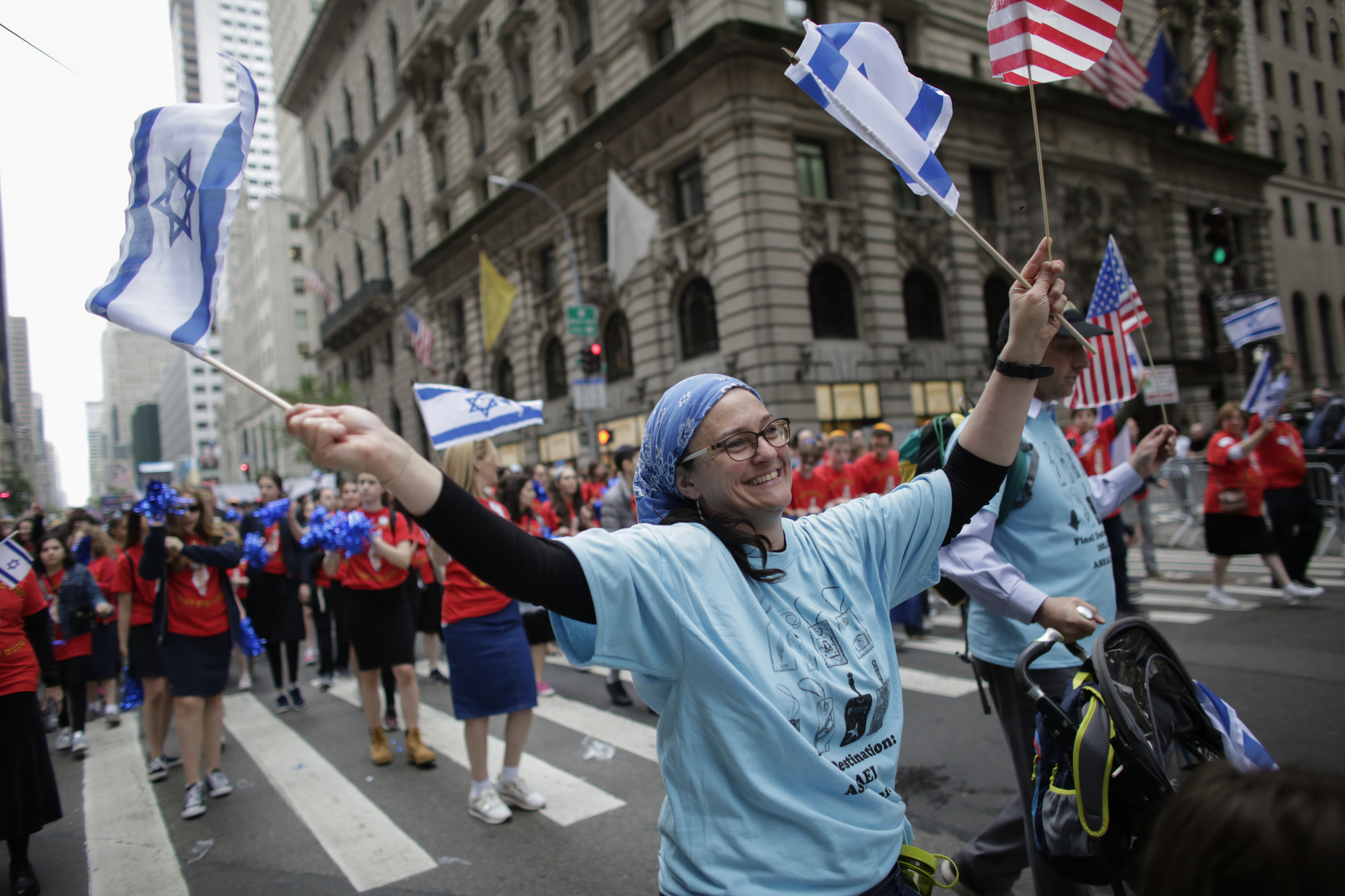 NEW YORK, NY - People march the annual Celebrate Israel Parade on June 3, 2018 in New York City.  (Kena Betancur/Getty Images/AFP)