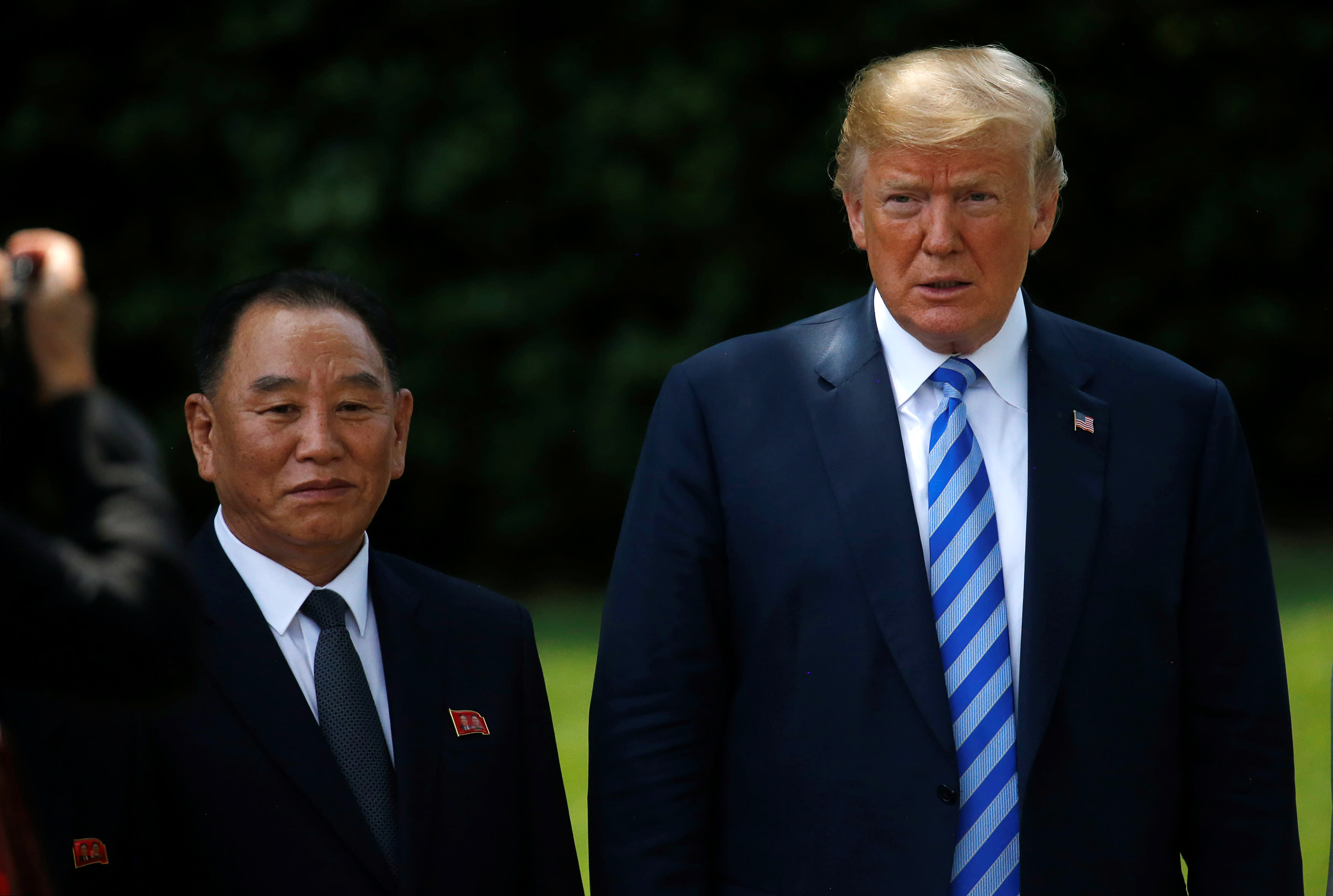 North Korea's envoy Kim Yong Chol poses with US President Donald Trump for a photo as he departs after a meeting at the White House in Washington, US, June 1, 2018 (Reuters/Leah Millis)