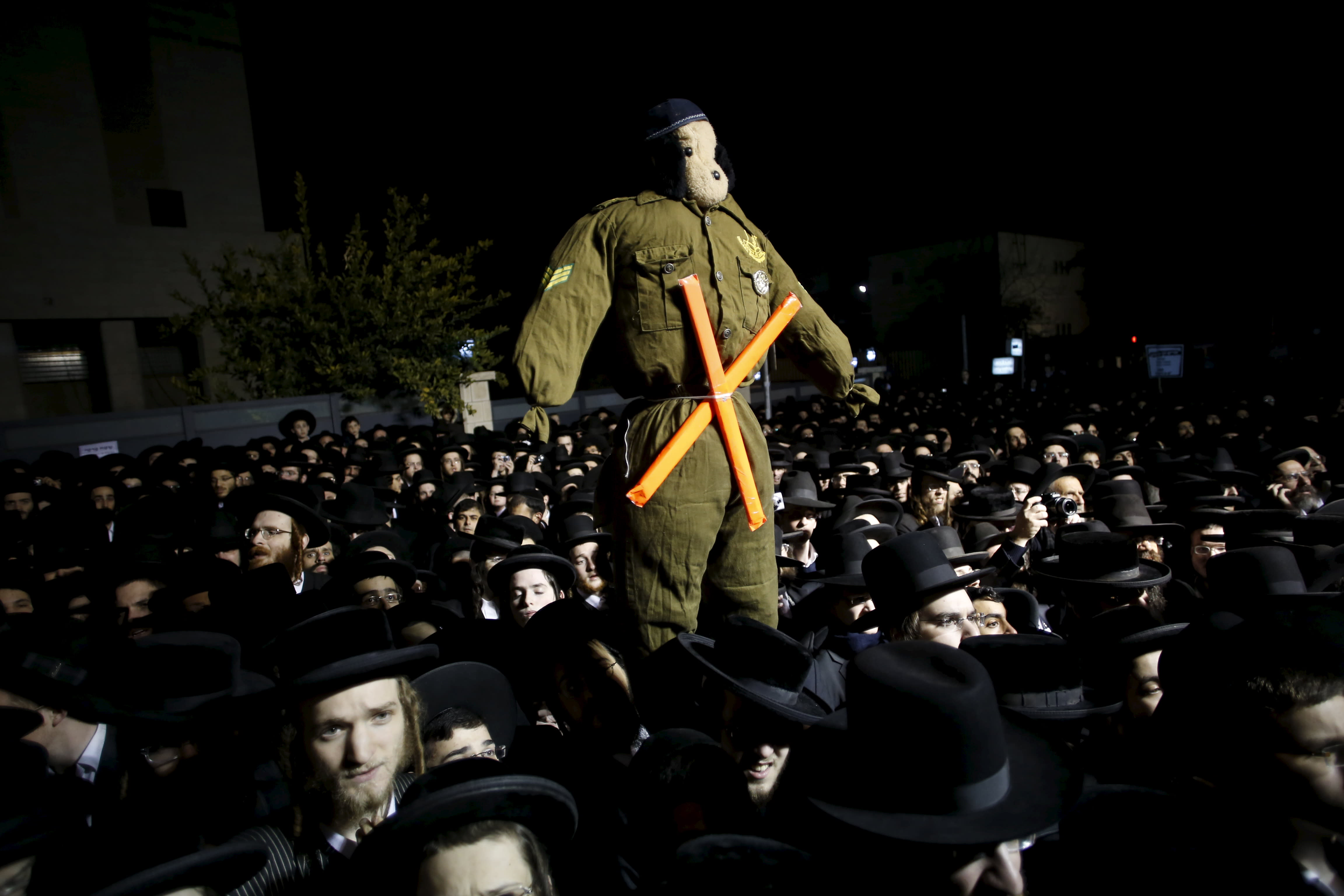 Ultra-Orthodox Jews attend a protest against a law calling for members of their community to serve in the army. (Reuters)