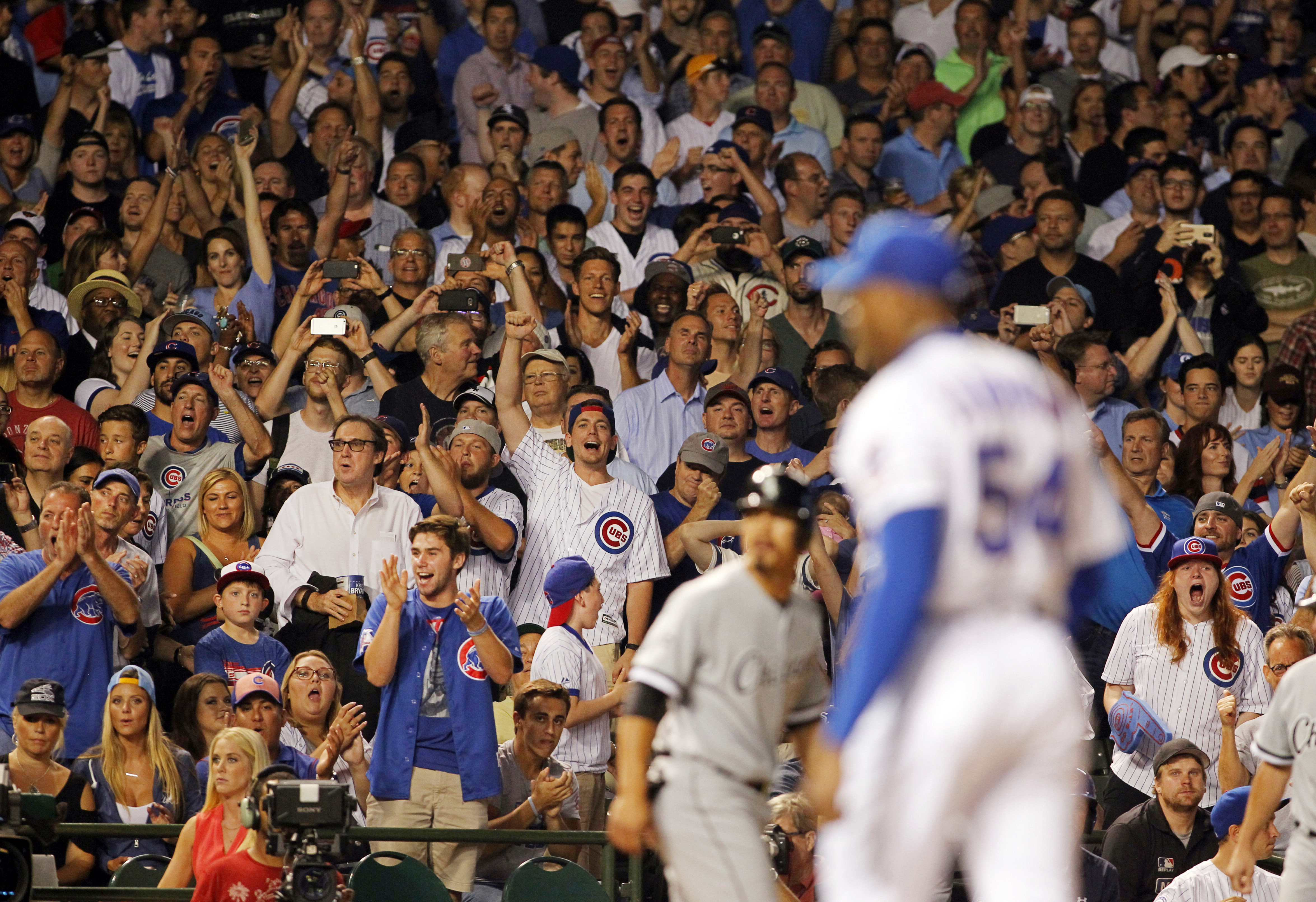 Fans celebrate during a Chicago Cubs game against the Chicago White Sox at Wrigley Field. (Reuters)