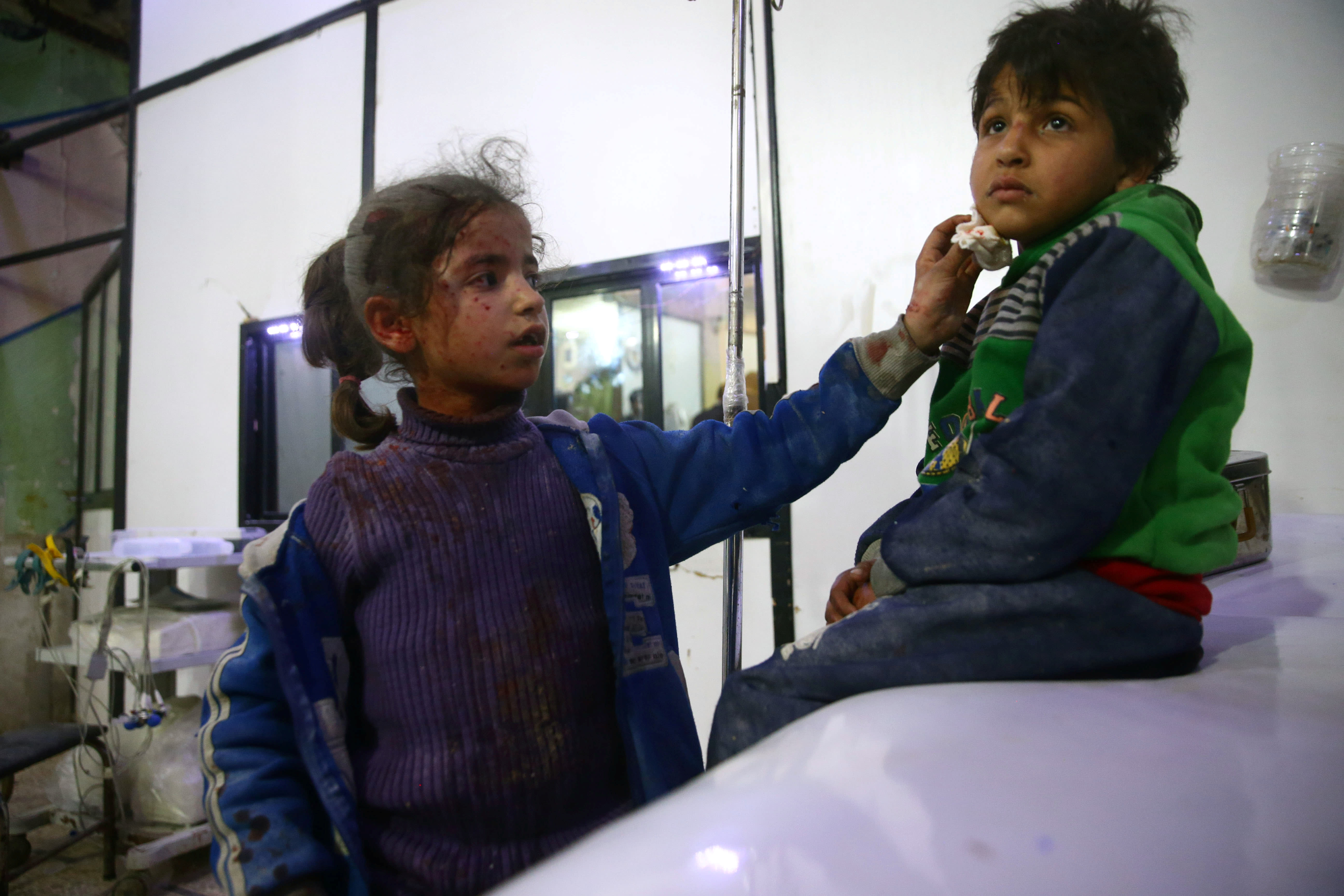 Wounded children are seen in a hospital in the besieged town of Douma, Eastern Ghouta, Damascus, Syria February 23, 2018. (Reuters)