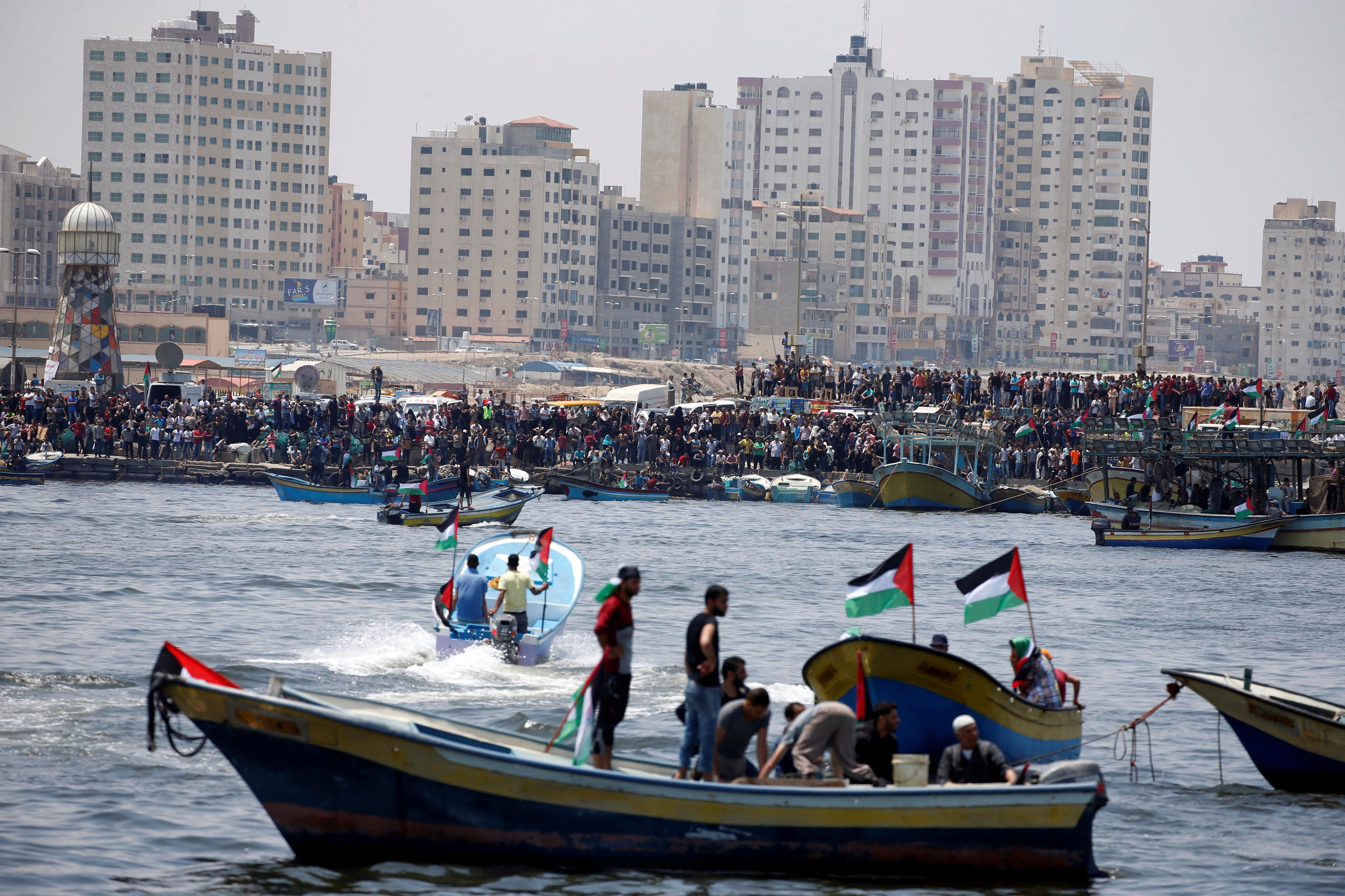 People watch as a boat prepares to set sail in attempt to break Israel's maritime blockade on Gaza, May 29, 2018. (Reuters)