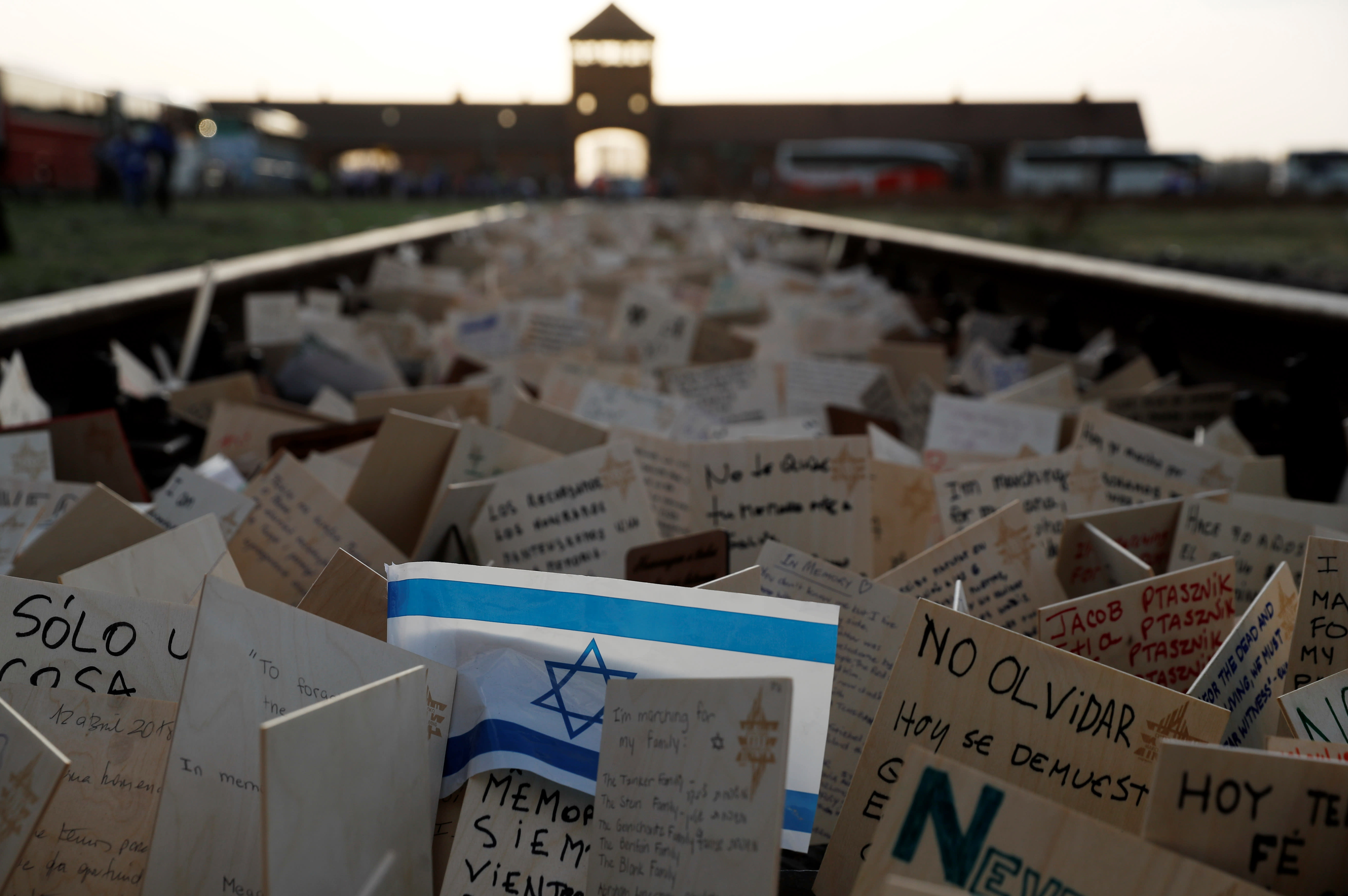 "Cards are placed between railway tracks in the former Nazi death camp Auschwitz as people take part in the annual ""March of the Living"" to commemorate the Holocaust, in Oswiecim, Poland, April 12, 2018. (KACPER PEMPEL/REUTERS)"