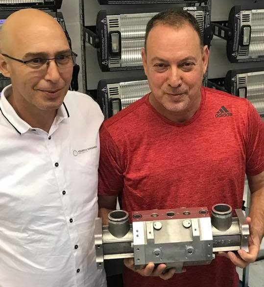Shaul Yaakoby, the inventor, and Gal Fridman, chief marketing officer, show off the super-efficient Aquarius engine. (Credit: Aquarius Engines)