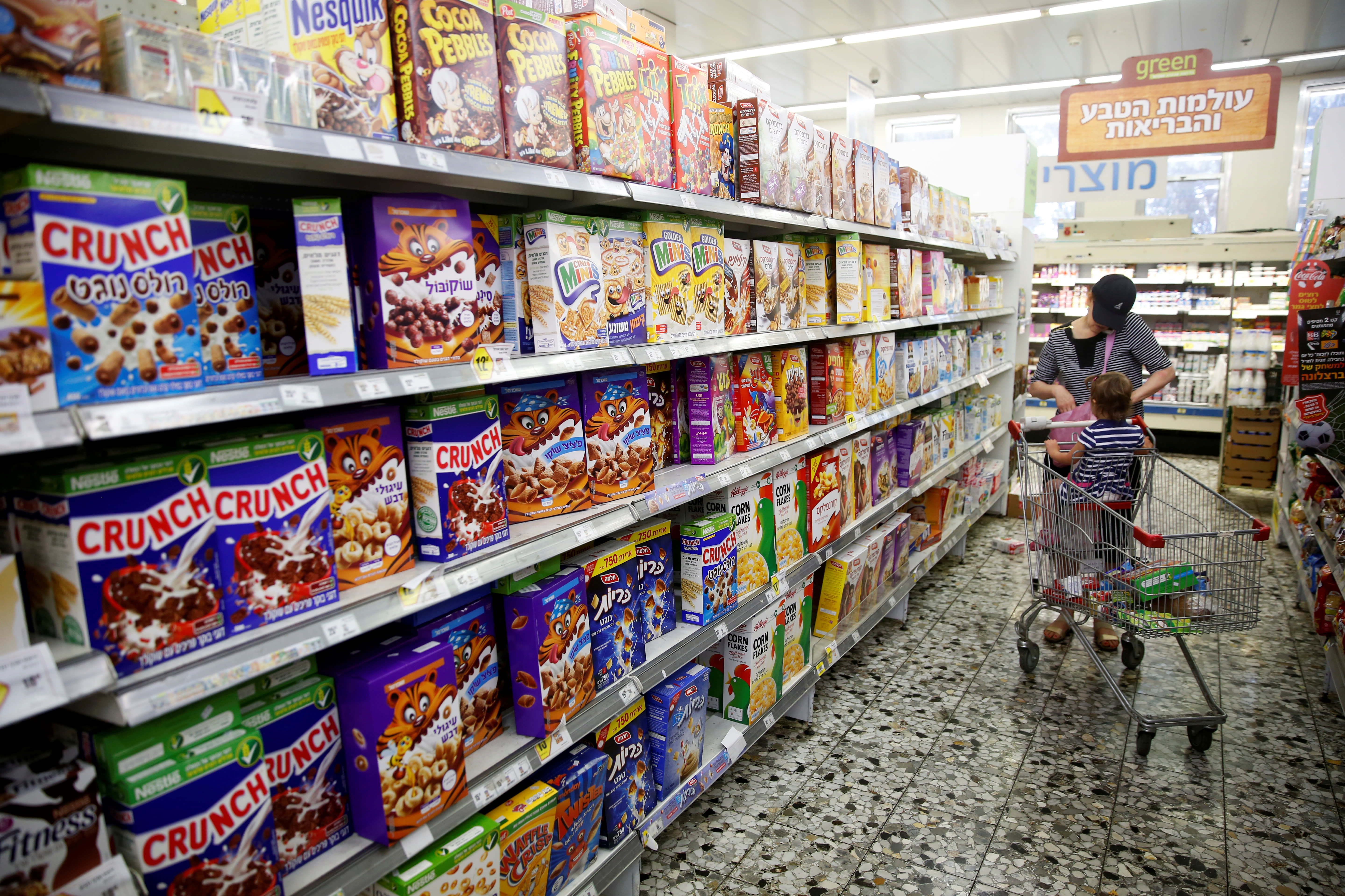 An Israeli woman shops at a Jerusalem supermarket (Reuters)