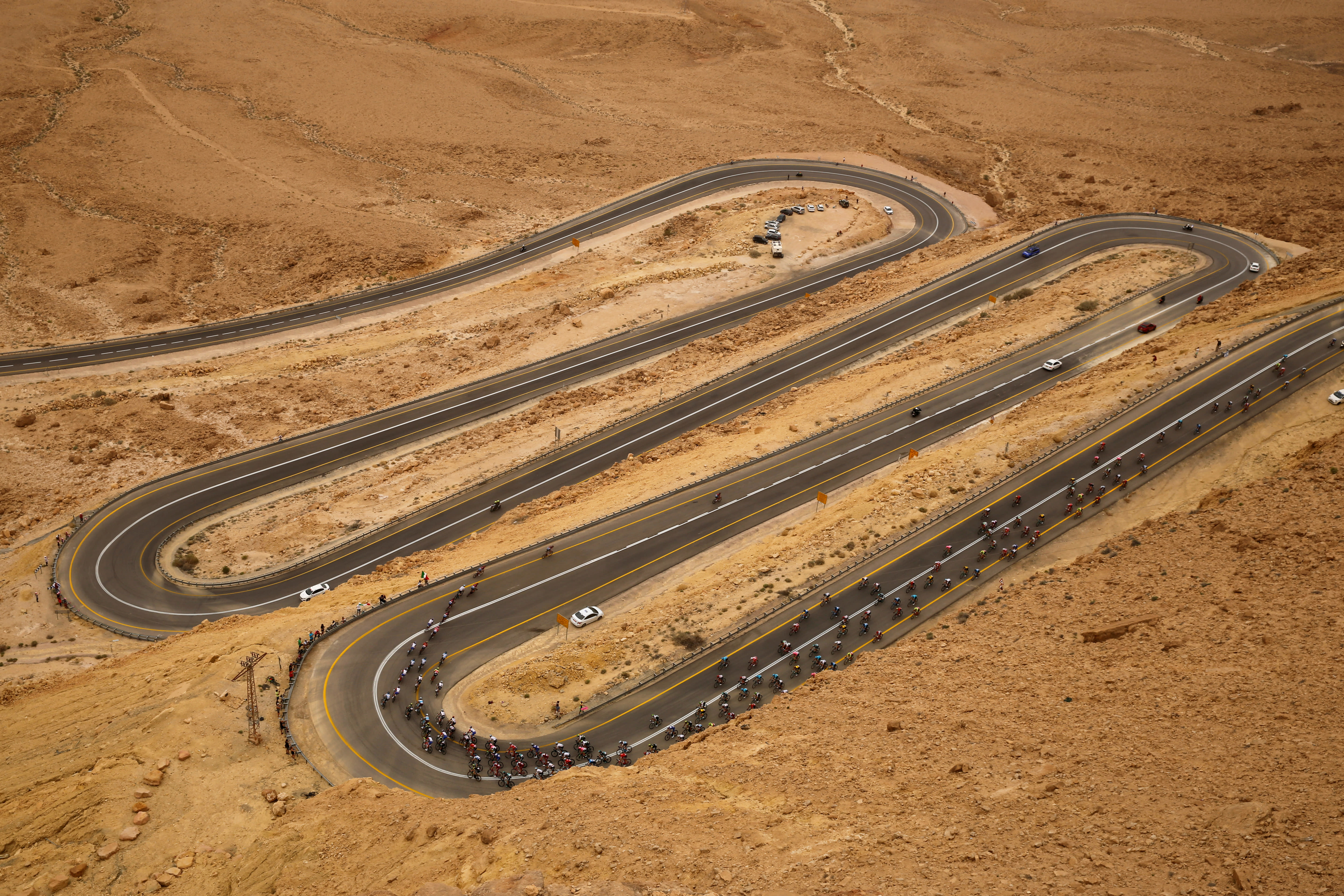 Riders compete on a main road near Mitzpe Ramon during stage 3 of the 101st Giro d'Italia cycling race from Beersheba to Eilat, Israel, May 6, 2018 (photo credit: REUTERS/AMIR COHEN)
