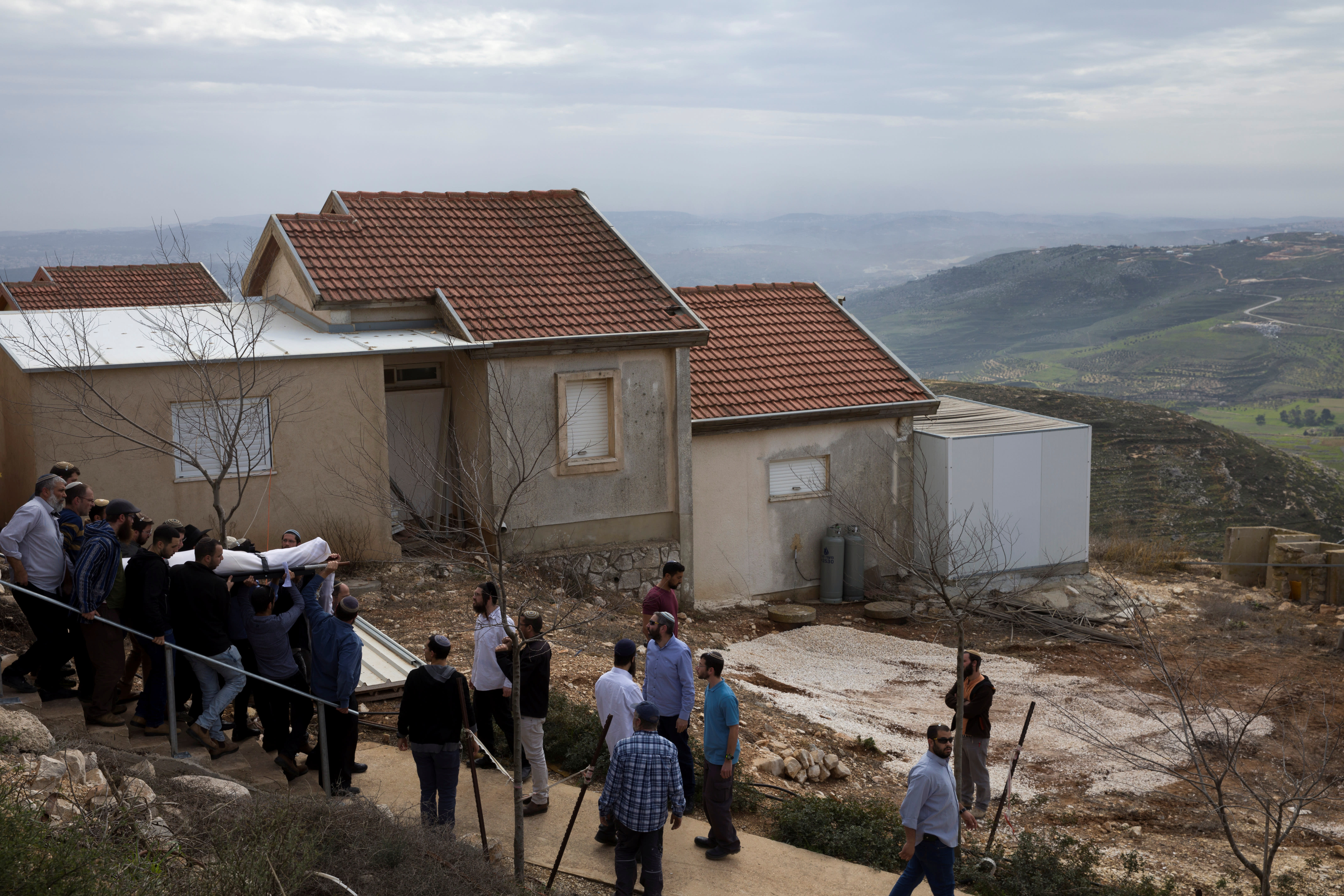 Relatives and friends carry the body of Itamar Ben Gal during his funeral in the Jewish settlement of Har Bracha in the West Bank, February 6, 2018. (Reuters/Jim Hollander/Pool)