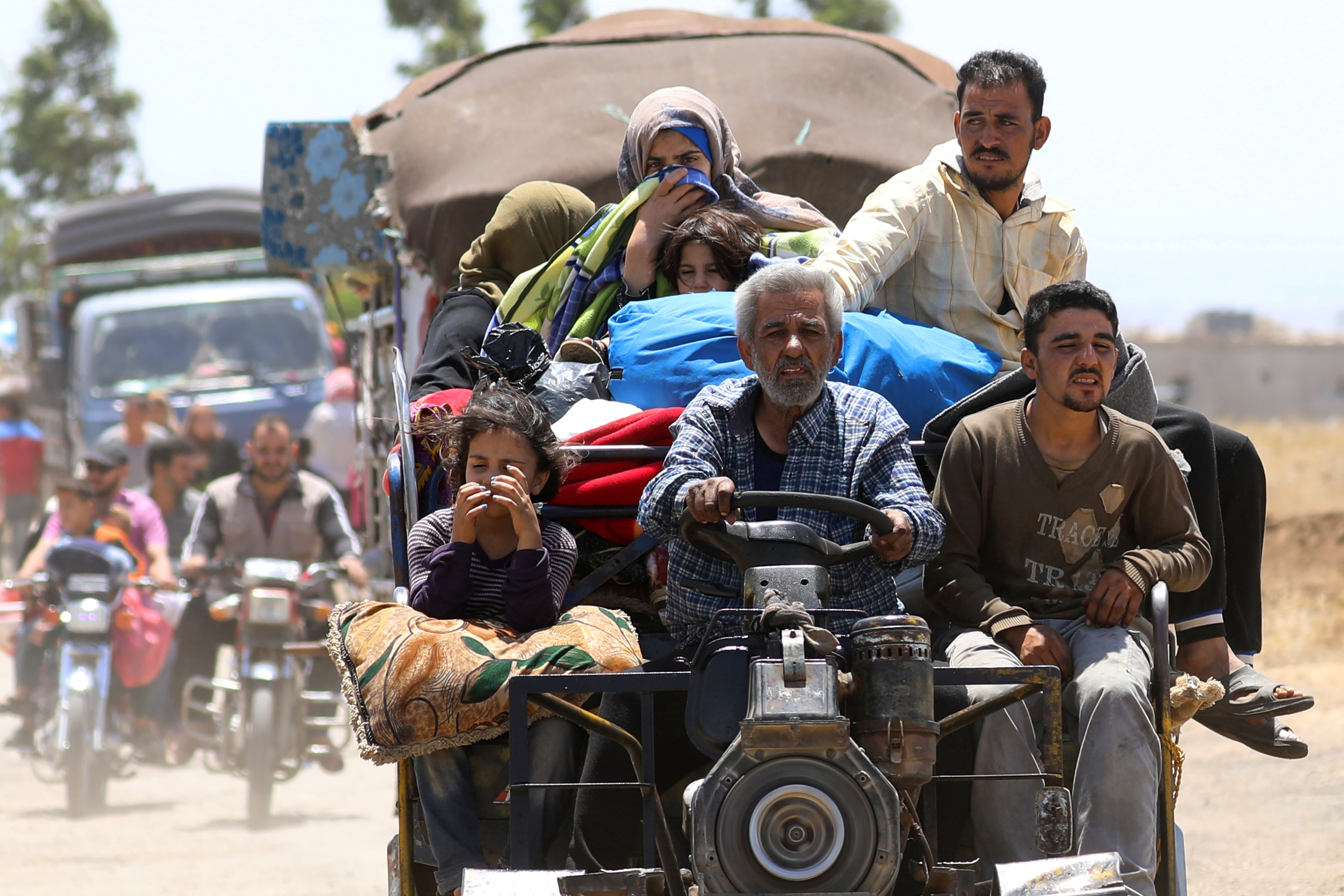 Internally displaced people from Deraa province arrive near the Golan Heights in Quneitra, Syria June 29, 2018. (REUTERS/ALAA AL-FAQIR)