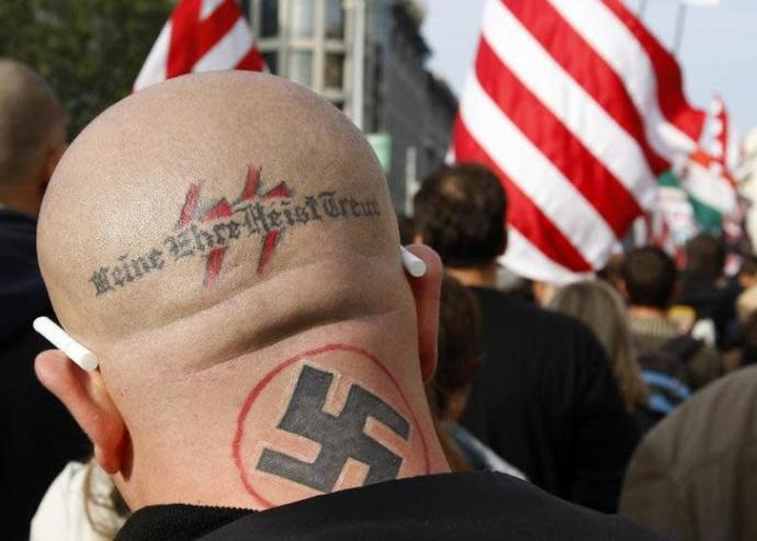 A neo Nazi attends a rally in Budapest October 23, 2009. The words, the motto of the S.S., read