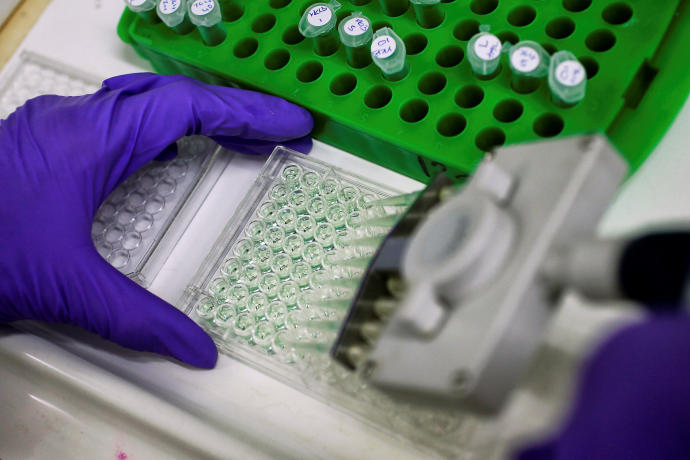 A scientist prepares protein samples for analysis in a lab at the Institute of Cancer Research in Sutton, Britain, July 15, 2013STEFAN WERMUTH/REUTERS