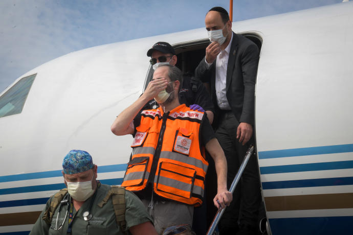 United Hatzalah founder and president Eli Beer closes his eyes to recite the 'Shema' as he arrives at Ben-Gurion International Airport on April 21YEHUDA HAIM/FLASH90