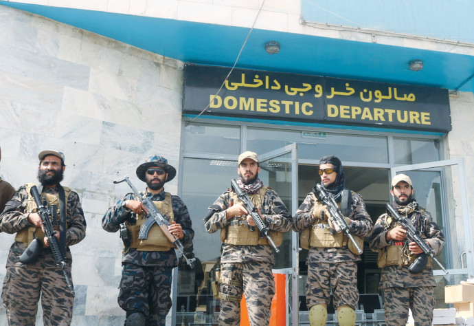 TALIBAN FORCES stand guard a day after the US troops withdrawal from Hamid Karzai International Airport in Kabul, Afghanistan, last month (REUTERS).