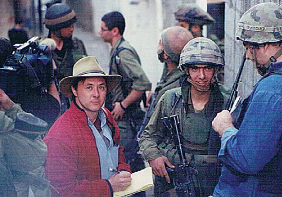 Arieh O'Sullivan speaks to paratroopers in the Balata refugee camp in Nablus during the Second Intifada (Courtesy)