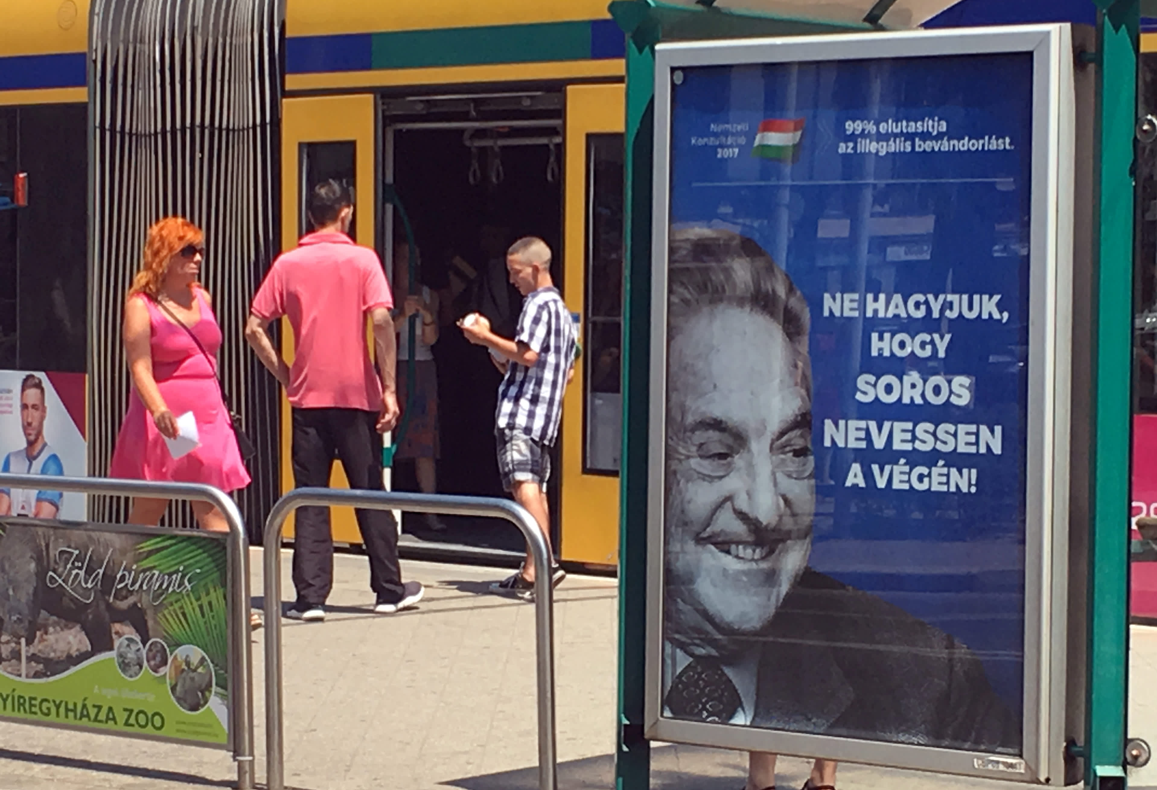 "Hungarian government poster portraying financier George Soros and saying ""Don't let George Soros have the last laugh"" is seen at a tram stop in Budapest, Hungary (REUTERS/KRISZTINA THAN)"