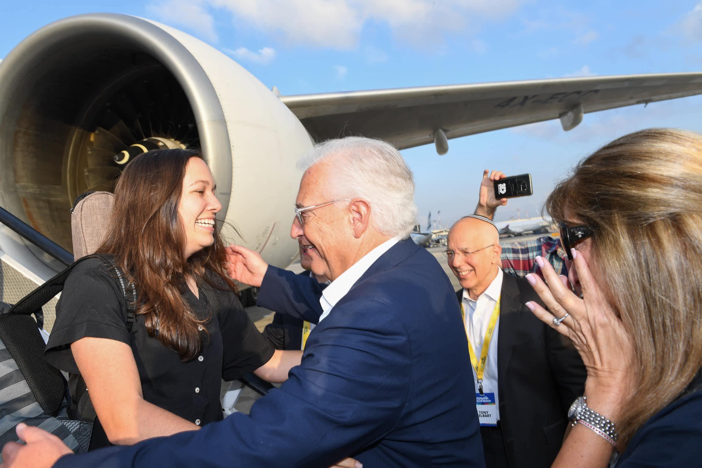 US Ambassador to Israel David Friedman greets his daughter at the airport as she makes aliya (Shahar Azran)