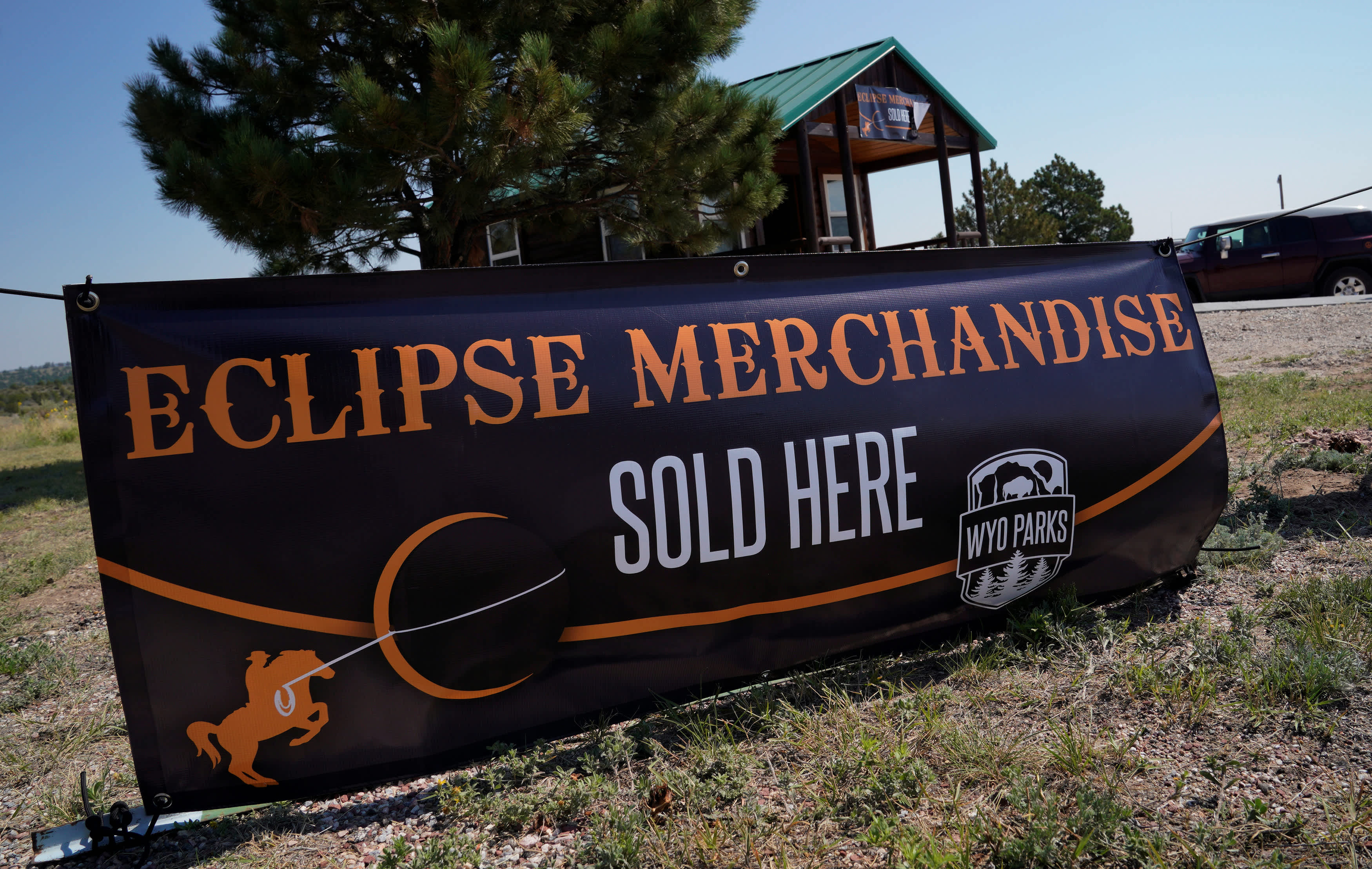 A sign advertises eclipse merchandise in Wyoming, US (Rick Wilking / Reuters)