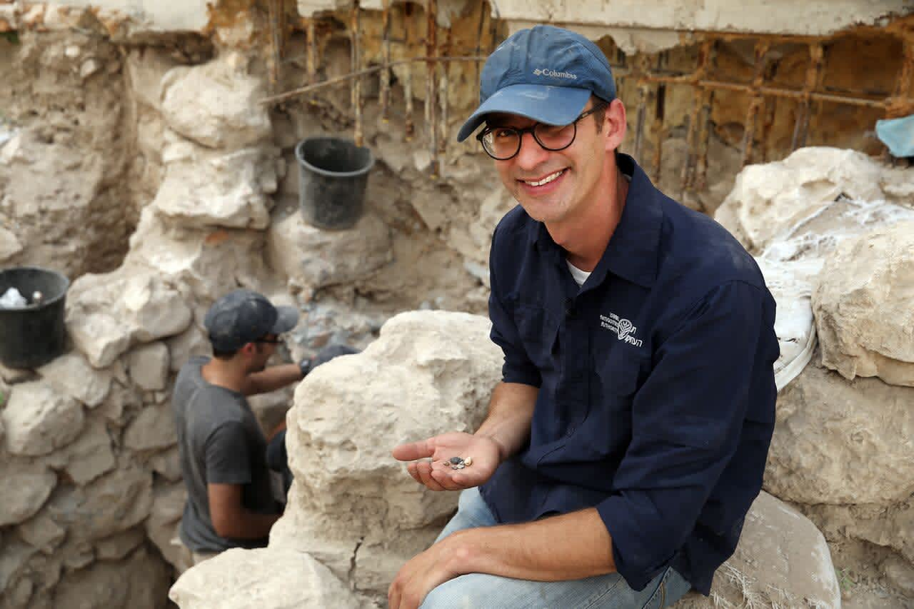 Dr. Joe Uziel with ancient seals at the City of David. (Eliyahu Yania/ The City of David)