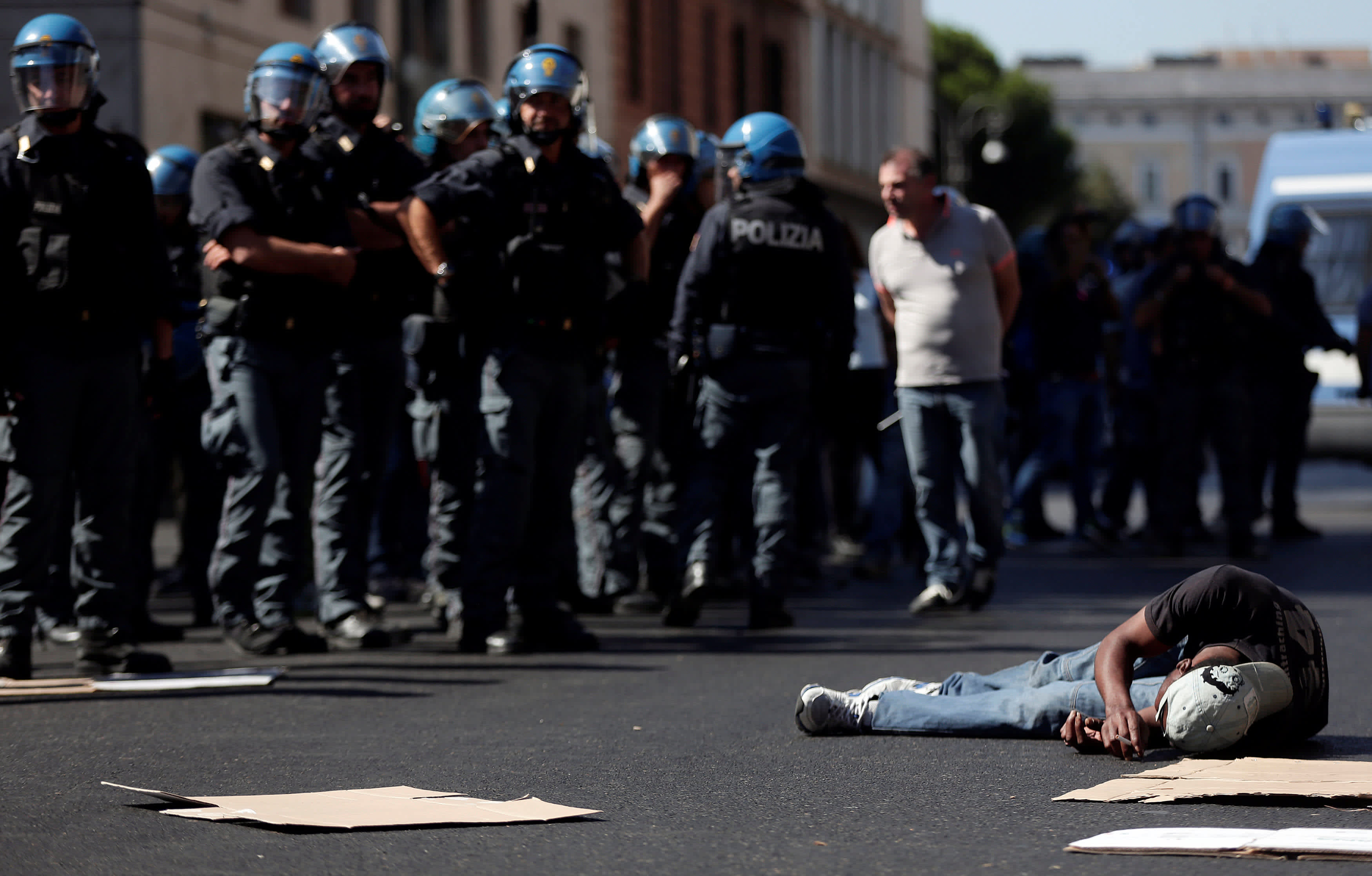 A refugee protests in the street after being forcibly removed from a building where he had been living, in central Rome, Italy August 23, 2017 (REUTERS/YARA NARDI)