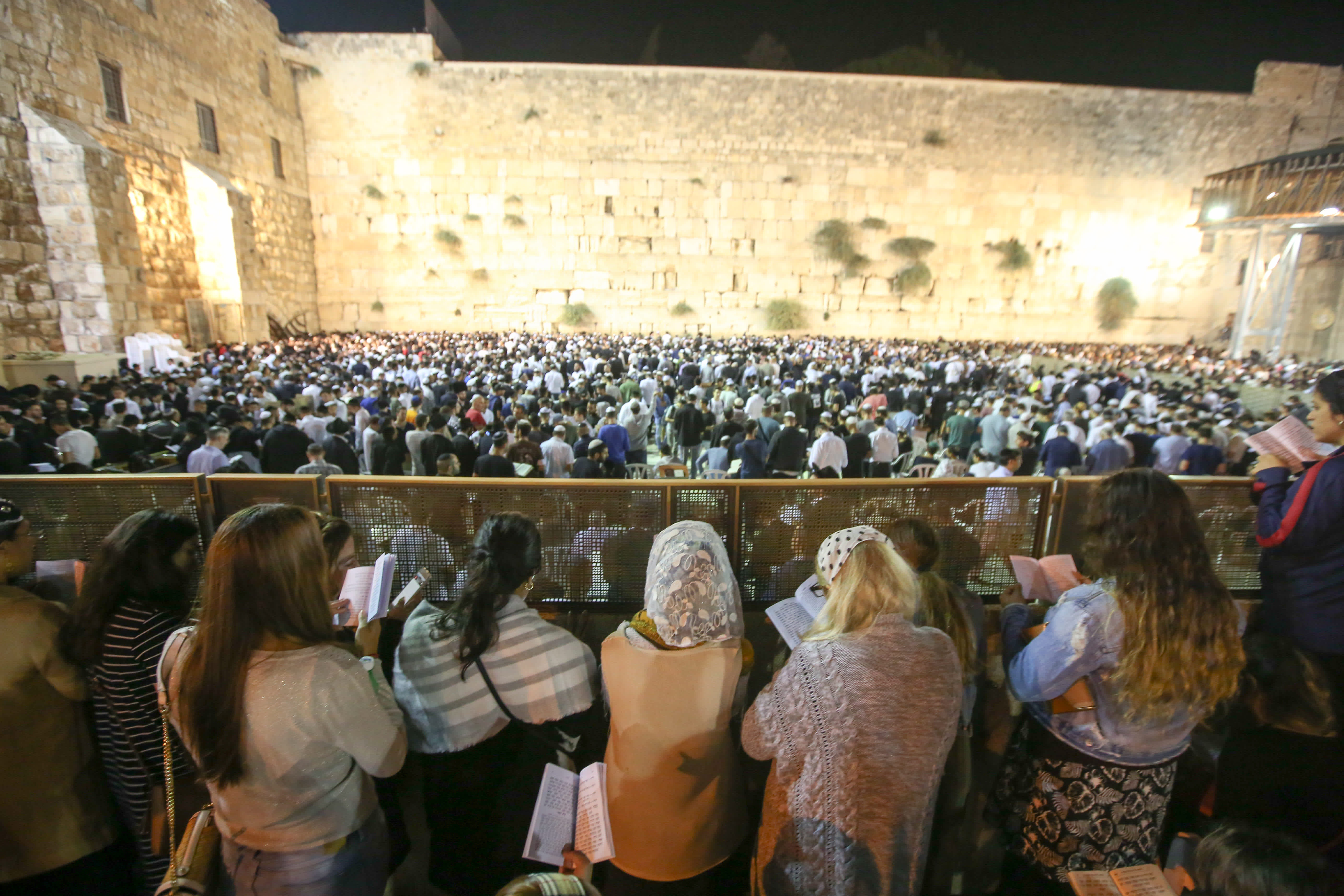 Women reading selichot at the Western Wall before Rosh Hashana