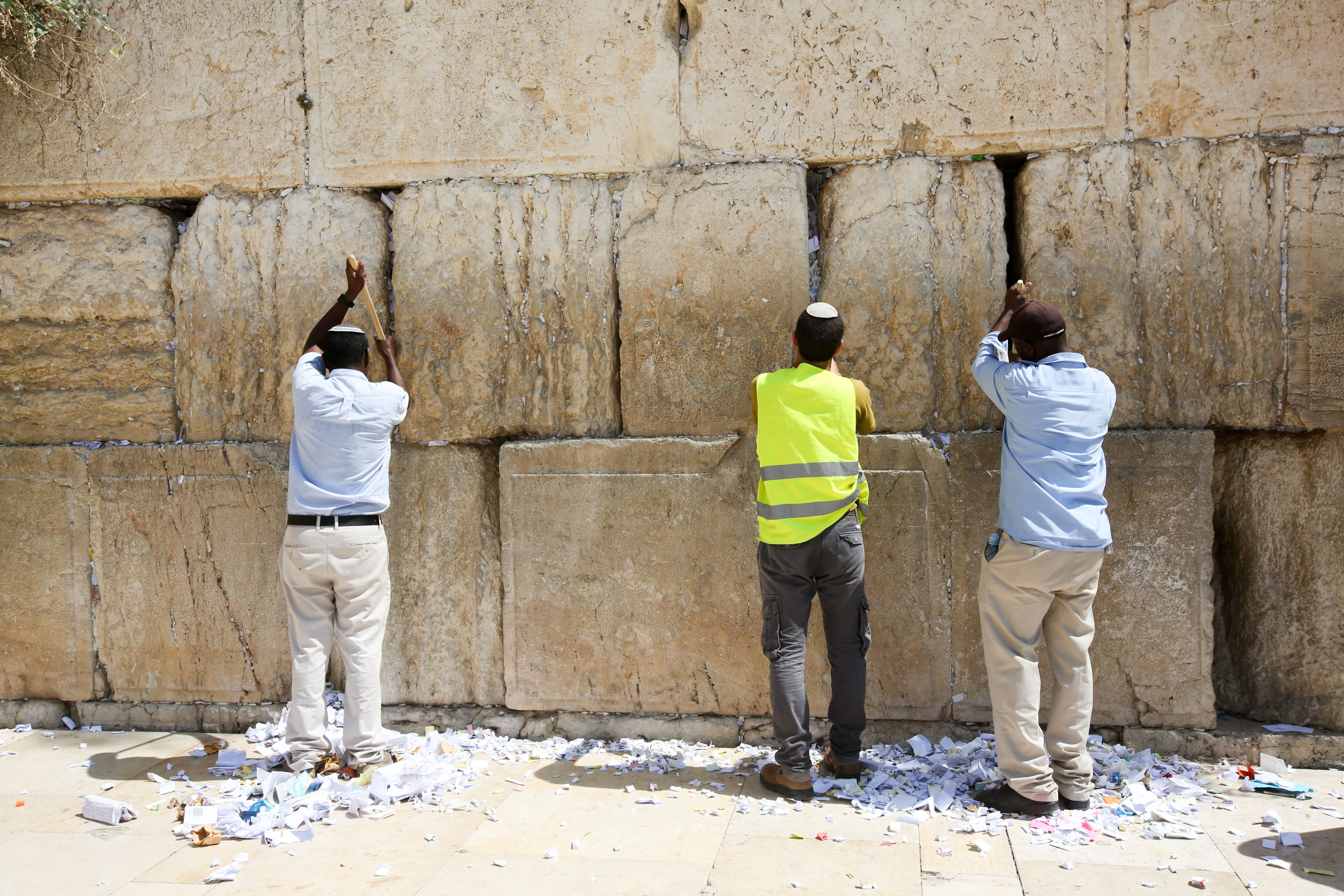 Jews clearing out notes from the Western Wall