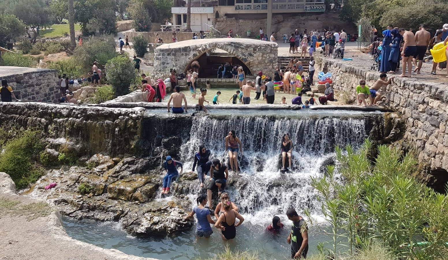 Israelis enjoy the warm weather at Gan Hashlosha National Park.