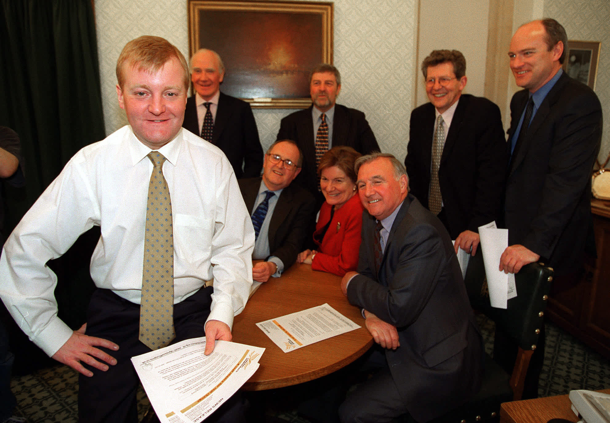 Leader of the British Liberal Democrats Charles Kennedy (L) poses with members of his electoral team including Baroness Jenny Tonge in his office inside the Houses of Parliament May 8, 2001. (Reuters)