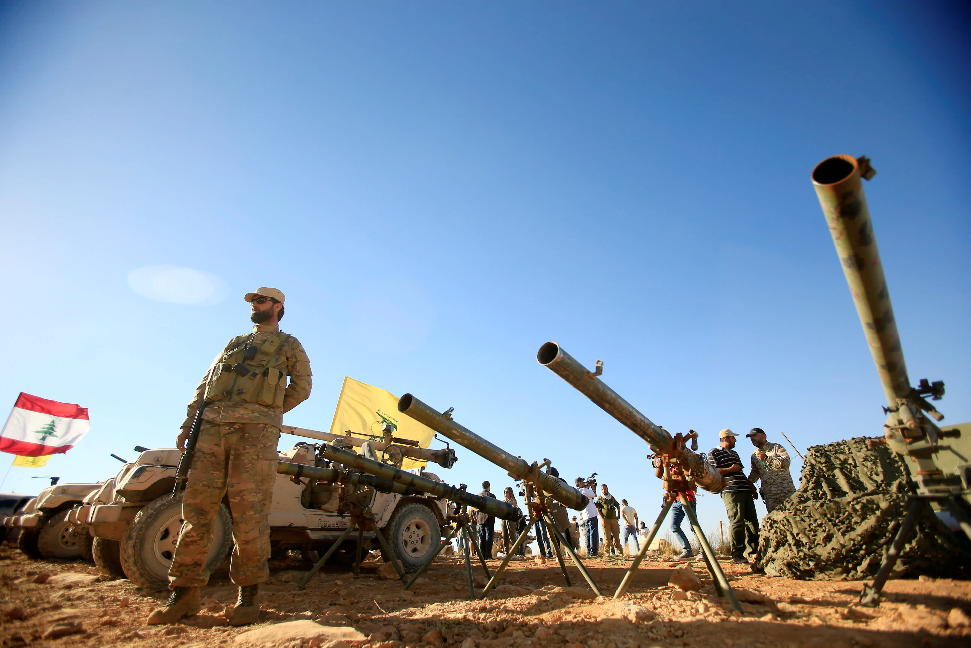 A Hezbollah fighter stands in front of anti-tank artillery at Juroud Arsal, the Syria-Lebanon border (Reuters)