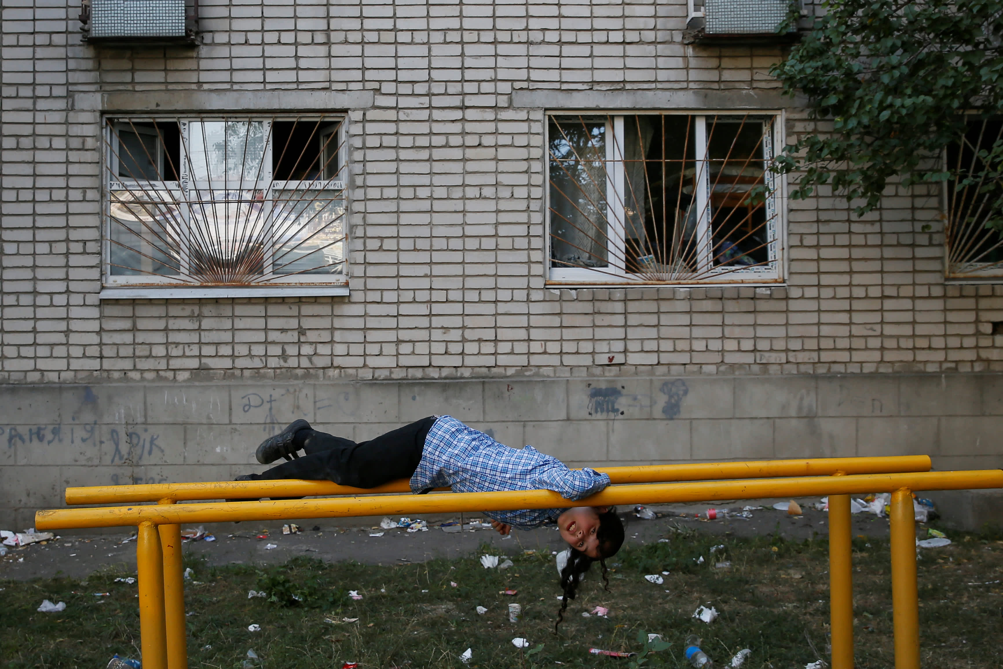 An ultra-Orthodox Jewish boy practises on the bars on the eve of Rosh Hashana holiday, the Jewish New Year, near the tomb of Rabbi Nachman of Breslov in the town of Uman, Ukraine September 20, 2017. (Reuters)