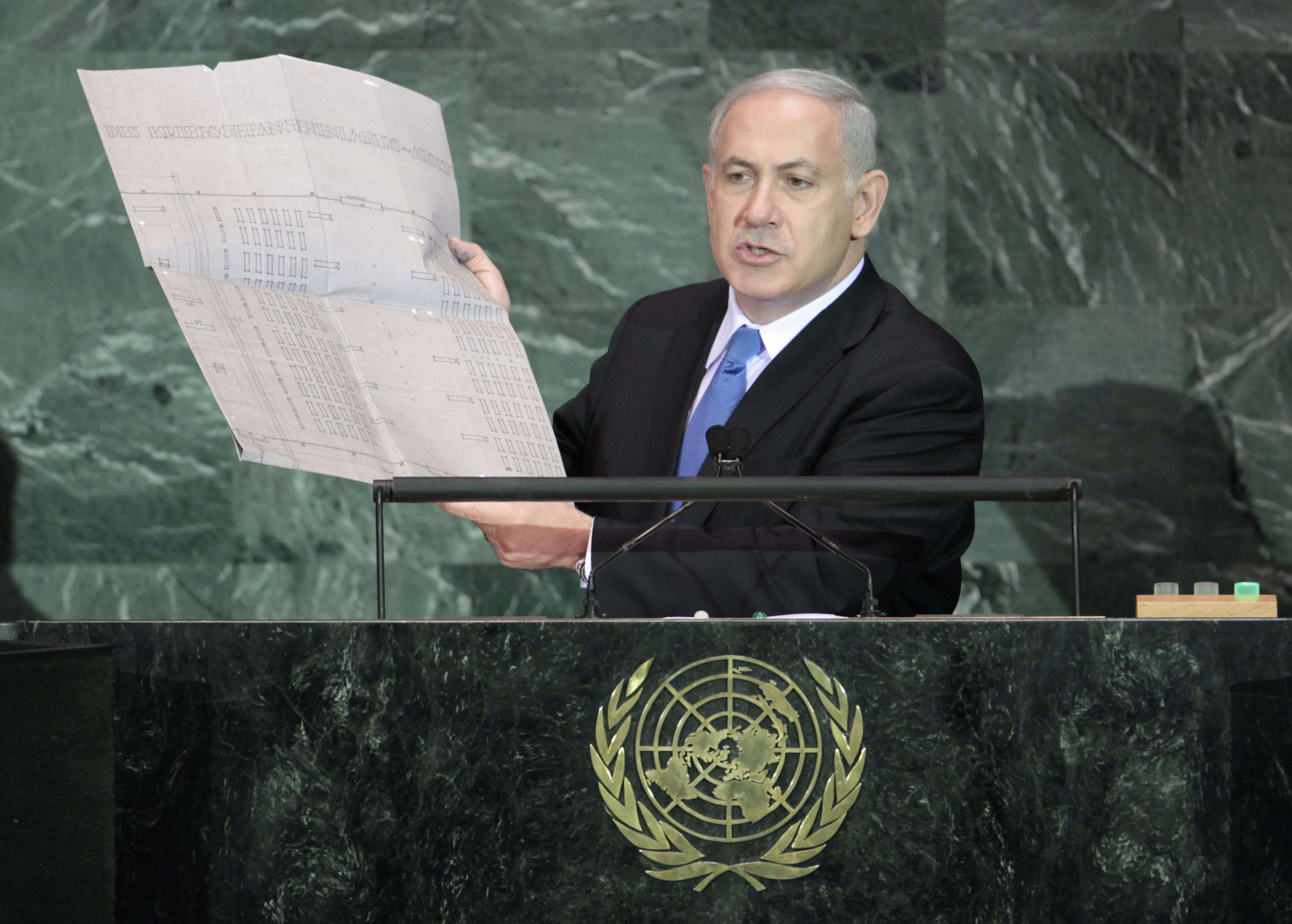 Israeli Prime Minister Benjamin Netanyahu holds up a document outlining plans for the Auschwitz death camp as he addresses the 64th United Nations General Assembly at UN headquarters in New York, September 24, 2009. (Reuters)