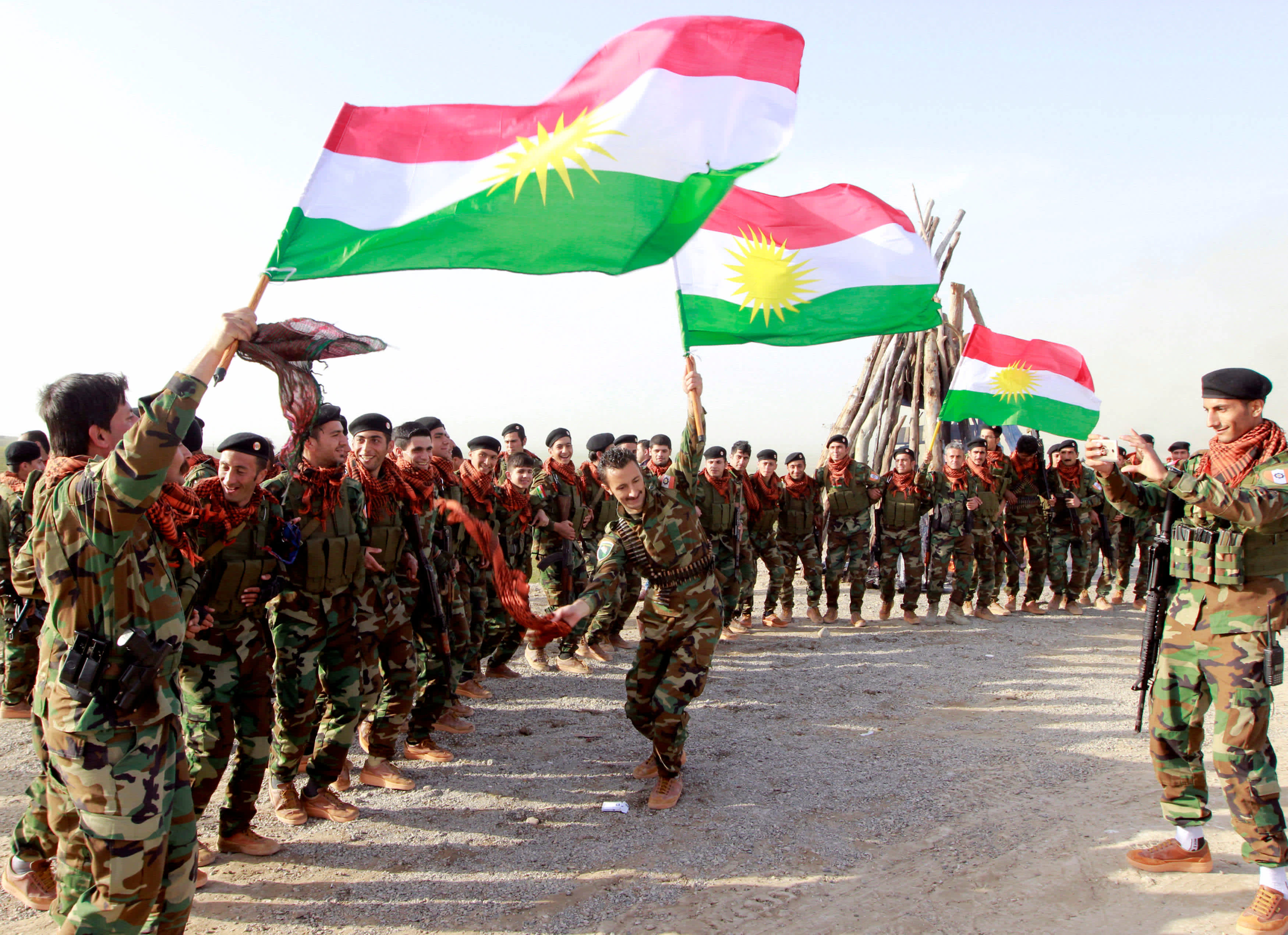 Kurdish Peshmerga forces celebrate Newroz Day, a festival marking spring and the new year, in Kirkuk March 20, 2017 (Reuters)